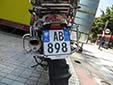 Motorcycle plate. TR = Tiranë. 11 = registered in 2011<br>'TR' and '11' are unofficial stickers.