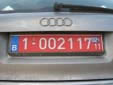 Temporary plate; valid until end of February 2011. 1 = standard plate<br>Blue sticker = taxes paid (while a red sticker means tax free)