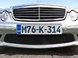 Foreign owned vehicle's plate (dark blue characters)