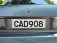 Normal plate (old style, white is normally front,<br>but on this car it is on the back)