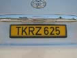 Taxi plate (rear, old style). T = taxi