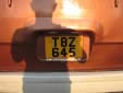 Taxi plate (rear). T = taxi