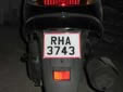 Governmental motorcycle plate. RHA = governmental vehicle