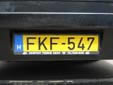 'Truck' plate on a bus. F = truck (also used on buses)<br>Yellow background = commercial vehicle