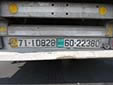 Left: trailer plate. TRL and 71 = trailer<br>Right: public transport plate of the pulling vehicle. 60 = truck