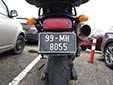 Military motorcycle plate. 99 = first registered in 1999<br>MH = Meath (An Mhí)