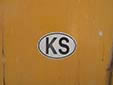 Oval sticker with the former official country code 'KS'