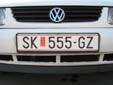 Normal plate (old style) with unofficial Macedonian flag. SK = Skopje