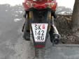 Motorcycle plate (old style) with unofficial shape. SK / СК = Skopje