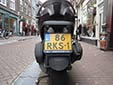 Normal plate (small size) on what looks like a motorcycle, but is a 3-wheel vehicle.<br>Therefore it has a 'car' plate and not a motorcycle plate (on a<br>motorcycle plate the three-letter combination begins with an M).