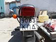 Motorcycle plate (old style from the former USSR)<br>&#1050;&#1055; = &#1050;&#1072;&#1088;&#1072;&#1082;&#1072;&#1083;&#1087;&#1072;&#1082;&#1089;&#1090;&#1072;&#1085; (Karakalpakstan autonomous republic)